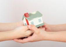 House in kids hands Royalty Free Stock Image