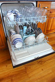 House Kitchen Dishwasher Full of Clean Dishes stock photo