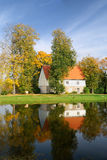 House at the lake bank in autumn Royalty Free Stock Photos