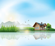 House at the lake. Beautiful sunny landscape with house and a lake Stock Images