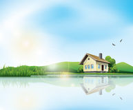 House at the lake. Beautiful sunny landscape with house and a lake Stock Photos
