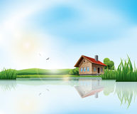 House at the lake. Beautiful sunny landscape with house and a lake Royalty Free Stock Photos