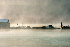 House on lake in foggy morning Stock Photography