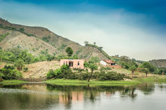 House by lake hill Royalty Free Stock Photography