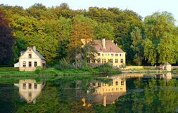 House on the lake. Houses on the lake, reflected in the water, in an idyllic setting Stock Images