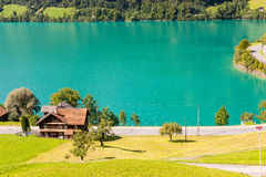 House on the Lake Lungern in Switzerland. Idyllic segment of the famous Lake Lungern in Switzerland royalty free stock photos