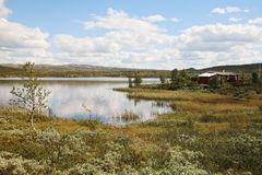 House and Lake in Norway Royalty Free Stock Photos
