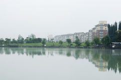 House lake. A row of apartments by side of lake after rain Royalty Free Stock Photos