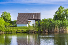 House on lake shore Royalty Free Stock Image