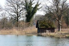 House at a lake. Small house at a lake Royalty Free Stock Photos