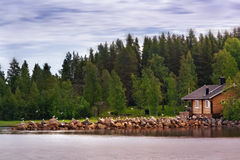 The house from the lake. A summer house near the lake Royalty Free Stock Photos