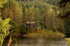 House on a lakes island Royalty Free Stock Photo
