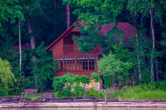 The house on the lakeshore. The wooden house on the lakeshore Stock Photo