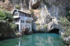 House on lakeside. With cave Royalty Free Stock Image