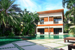 House with a landscaped swimming pool. In Thailand Stock Photo