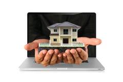 House on laptop Stock Photo
