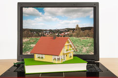 House on laptop Stock Photography