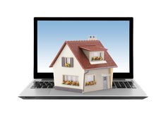 House on laptop isolated on white Royalty Free Stock Photos