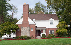 House with Large Fireplace Chimney. Midwest house in red brick & white siding with large, stone fireplace chimney stock photos