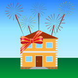 House on the lawn. Tied with a festive ribbon, fireworks in the sky Royalty Free Stock Photo