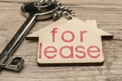 House for lease. House key with wooden house key chain writing for lease Royalty Free Stock Photo
