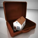 House in leather suitcase over white reflecting background Stock Image