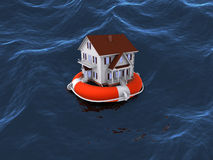 House on lifebuoy in water Royalty Free Stock Image