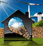 House with Light bulb and Renewable Resources. 3D illustration of a model house with a light bulb, solar panels, wind turbines, firewood logs and a power line on Stock Image