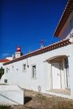 House lighthouse. House of white stone lighthouse Stock Photos