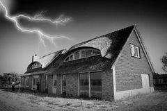 House lightning bad weather. People looking for shelter for lightning thunder at a empty house Royalty Free Stock Photography