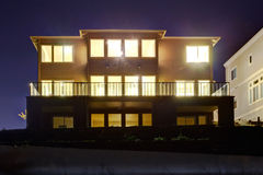 House with lights on. NIght view Stock Photo