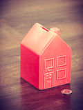 House like cash box. Finance mortgage housing real estate savings concept. House like cash box. Piggy bank in home shape with coin Stock Images