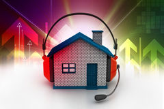 House listening to music. While holding headphones Stock Photo