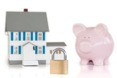 House locked with padlock and piggy bank Stock Images