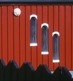House at Longyearbin, Spitzbergen. A somewhat abstract photograph of windows behind a wooden fence Royalty Free Stock Images