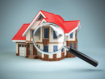 House and loupe magnifying glass. Real estate searching concept. Royalty Free Stock Photo