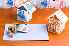 House made of bank notes with a calculator Royalty Free Stock Photo