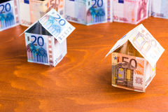 House made of bank notes on a desk Royalty Free Stock Images