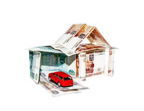 House made of banknotes with a toy car Stock Image