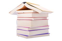 House made with books piled. On white background stock image