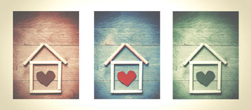 House made of chalk with red heart in it on wooden background, t Royalty Free Stock Images