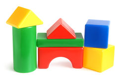 House made from children's building blocks. House made from children's plastic building blocks on a white background royalty free stock photos