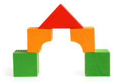 House made from children's wooden building blocks. On a white background stock photos