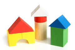 House made from children's wooden building blocks. On a white background royalty free stock images