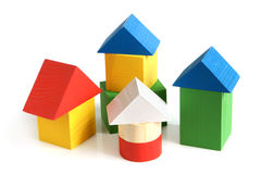 House made from children's wooden building blocks. On a white background stock photo