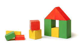 House made from colorful building blocks. Simple house made from colorful wooden building blocks royalty free stock images