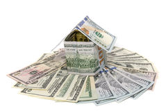House made from dollar bills with key isolated Stock Image
