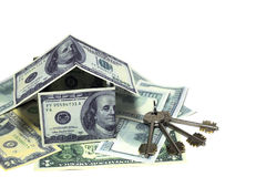 House made from dollar bills with key. On white background Stock Photos