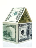 House made from dollars. Closeup of house formed from one hundred dollar bills, isolated on white background Stock Photography