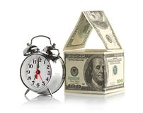 House made of dollars and alarm clock. Royalty Free Stock Photo
